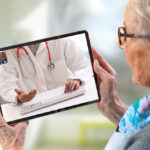 Older woman using telehealth on her tablet